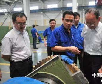 中国纺织工业联合会党委书记高勇一行到郑纺机参观指导